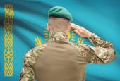 National military forces with flag on background conceptual series - Kazakhstan — Stock Photo