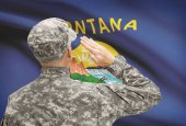 Soldier saluting to US state flag series - Montana — Stock Photo