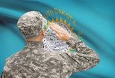 Soldier saluting to US state flag series - South Dakota — Stock Photo