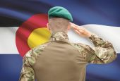 Soldier saluting to USA state flag conceptual series - Colorado — Stock Photo