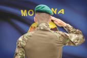 Soldier saluting to USA state flag conceptual series - Montana — Stock Photo