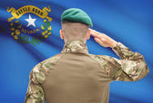 Soldier saluting to USA state flag conceptual series - Nevada — Stock Photo