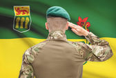 Soldier saluting to Canadial province flag conceptual series - Saskatchewan — Stock Photo