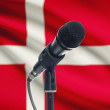 Microphone on stand with national flag on background - Denmark — Stock Photo #77535080