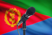 Microphone on stand with national flag on background - Eritrea — Stock Photo