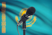 Microphone on stand with national flag on background - Kazakhstan — Stock Photo