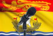 Microphone on stand with Canadian province flag on background - New Brunswick — Stock Photo