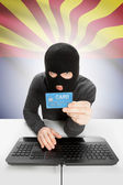Hacker holding credit card with US state flag on background - Arizona — Stock Photo