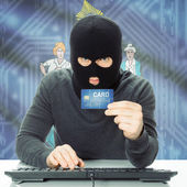 Hacker holding credit card and USA state flag - Maine — Stock Photo