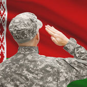 Soldier in hat facing national flag series - Belarus — Stock Photo