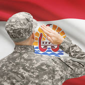 Soldier in hat facing national flag series - French Polynesia — Stock Photo