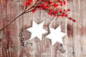 Christmas decoration hanging over wooden background  — Stock Photo