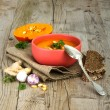 Pumpkin soup in bowl on wooden background  — Stock Photo #56835085