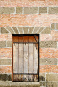 Old Barred Window on a Brick and Stone Wall — Stock Photo