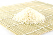 Uncooked rice on a napkin — Stock Photo