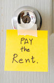 Sticky note write a message pay the rent  — Stock Photo