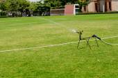 Watering in football field — Stock Photo