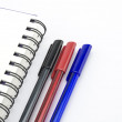 Black red and blue pen with notebook isolated on white — Stock Photo #54428157
