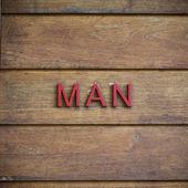 Man toilet symbolic on wood background — Stock Photo