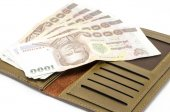 Thai banknote in brown wallet — Stock Photo