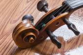Violin on wood background — Stock Photo