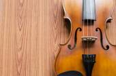 Violin on wood background — Stockfoto