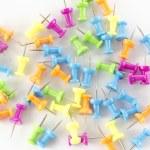 A lot of colorfull thumbtacks — Stock Photo #54906195