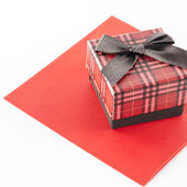 Red envoloper and scotch gift box isolated on white — Foto Stock