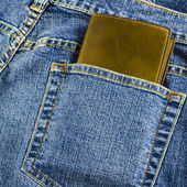 Blue jeans pocket with wallet — Stock Photo