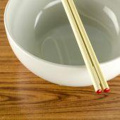 Empty white bowl with chopstick — Stock Photo