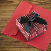 Red gift box and envelope — Stock Photo