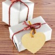 Brown gift box with heart tag card — Stock Photo #54933763