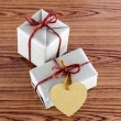 Brown gift box with heart tag card — Stock Photo #54933767