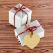 Brown gift box with heart tag card — Stock Photo #54933807