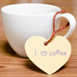 Coffee cup with heart tag write I love coffee word — Stock Photo #54936597