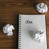 Notebook with crumpled paper — Stock Photo