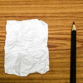 Paper scrap with pencil — Stockfoto