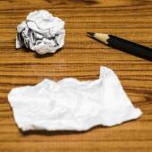 Paper scrap and crumpled with pencil — Stock Photo