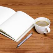 Coffee and notebook — Stock Photo