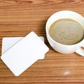 Coffee cup and business card — Стоковое фото