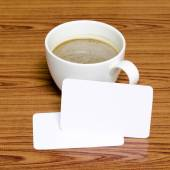 Coffee cup and business card — Stockfoto