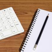 Keyboard computer with notenook and pencil — Stockfoto