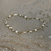 A heart on the sand in the beach — Stock Photo