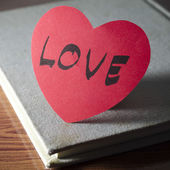 Notebook and heart — Stock Photo