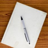 Notebook with pen — Stockfoto