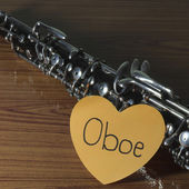 Oboe on wood background — 图库照片