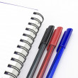 Black red and blue pen with notebook isolated on white — Stock Photo #54983059