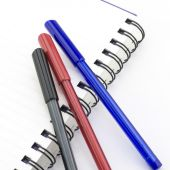 Black red and blue pen with notebook isolated on white — ストック写真