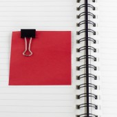 Paper note with clip on notebook — Stock Photo