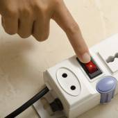 Hand turn on switch multiple  socket plug — Stock Photo